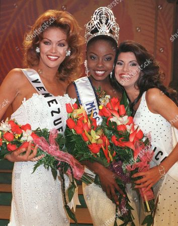 GIRAUD New Miss Universe Wendy Fitzwilliam of Trinidad and Tobago, center, poses with her 1st runner-up Miss Venezuela Veruska Ramirez, left, and 2nd runner-up Miss Puerto Rico Joyce Giraud at the end of the 47th Miss Universe contest in Honolulu, Hawaii, May12, 1998