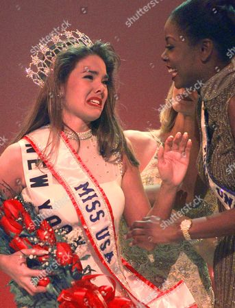 PRESSLER FITZWILLIAM Kimberly Ann Pressler, left, reacts as she is congratulated by Wendy Fitzwilliam, right, after being crowned Miss USA 1999, in Branson, Mo. Fitzwilliam is Miss Universe 1998. Pressler entered the pageant as Miss New York