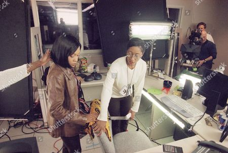 """Lead actress Monica Calhoun, left, and director Diane Wynter make some last minute preparations before shooting a scene for the black entertainment television movie """"Intimate Betrayals,"""" during location shooting in Sun Valley section of Los Angeles"""