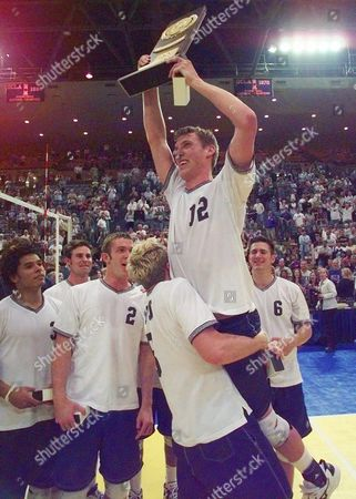 MILLAR Brigham Young's Ryan Millar is lifted by teammate Casey Jennings after BYU defeated Long Beach State 15-9, 15-7, 15-10 during the NCAA men's volleyball championship in Los Angeles on
