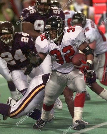 ANDERSON GRIFFITH Atlanta Falcons running back Jamal Anderson (32) is chased by Minnesota Vikings safety Robert Griffith (24) during the fourth quarter of the NFC Championship game, in Minneapolis. The Falcons came from 10 points down to tie the game in the fourth quarter and won it in overtime on a field goal by Morten Andersen