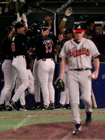 NEAGLE LEYRITZ Atlanta Braves starting pitcher Denny Neagle walks away as San Diego Padres Jim Leyritz is greeted by teammates after a sixth inning homerun in Game 4 of the National League Championship Series at San Diego's Qualcomm Stadium