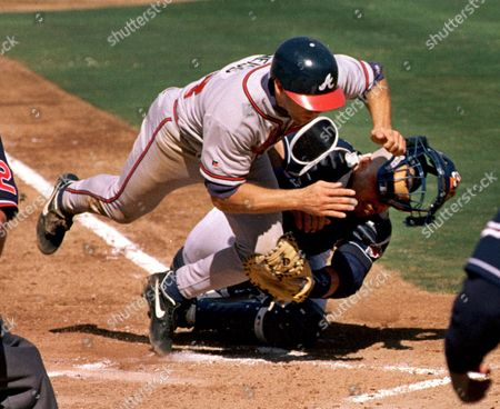 LEYRITZ WEISS Atlanta Braves' Walt Weiss, left, is out at home as he collides with San Diego Padres catcher Jim Leyritz during their National League playoff game, in San Diego. The Padres won the game 4-1, taking 3-0 lead in the series