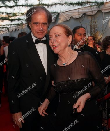 """MONTENEGO COHN Actress Fernanda Montenegro, nominated for a best actress Oscar for her role in the Brazilian film, """"Central Station,"""" arrives with the film's producer, Arthur Cohn, at the Academy Awards ceremony in Los Angeles"""