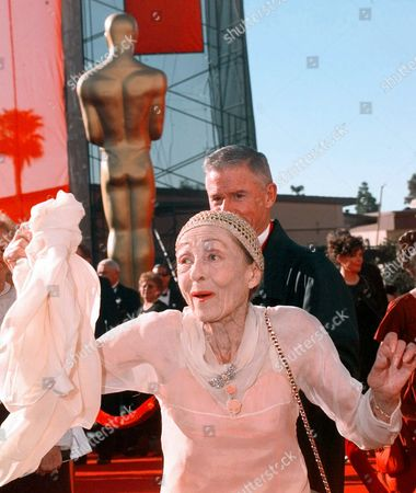 RAINER MCDOWELL Luise Rainer arrives with her escort Roddy McDowall, background, for the 70th Acadmey Awards in Los Angeles, . Rainer is the first two time Oscar winner for Best Actress in 1936 and 1937