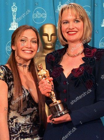 "DUDLEY LOPEZ Anne Dudley shows the Oscar she won for Original Musical or Comedy Score for the film ""The Full Monty,""at the 70th Academy Awards at the Shrine Auditorium in Los Angeles . At left is presenter Jennifer Lopez"