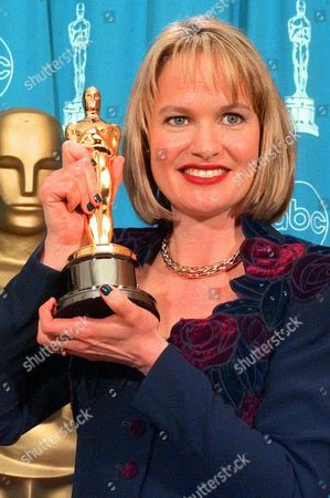 """DUDLEY Anne Dudley displays the Oscar she won for Best Original Musical or Comedy Score for """"The Full Monty,""""at the 70th Academy Awards at the Shrine Auditorium in Los Angeles"""