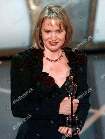 "DUDLEY Anne Dudley accepts her Oscar for Best Original Musical or Comedy Score for ""The Full Monty"" at the 70th annual Academy Awards in Los Angeles"