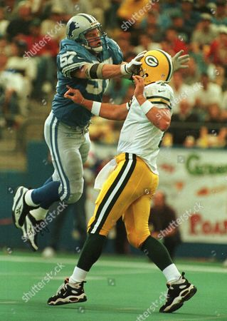 BOYD FAVRE Detroit Lions linebacker Stephen Boyd (57), puts pressure on Green Bay Packers quarterback Brett Favre during the first quarter at the Silverdome in Pontiac, Mich