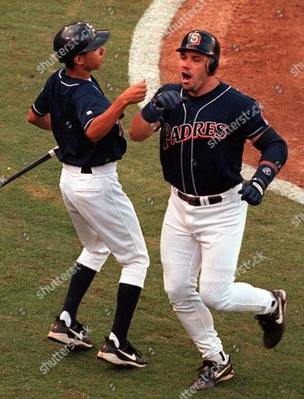 JIM LEYRITZ San Diego Padres' Jim Leyritz, right, and an unidentified batboy react after Leyritz hit a home run in the second inning against the Houston Astros in San Diego