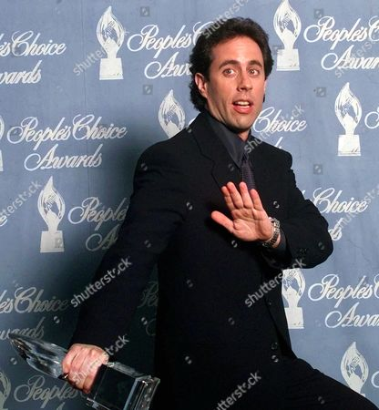 """SEINFIELD Comedian Jerry Seinfield jokes around backstage after his hit series """"Seinfield"""" was awarded """"Favorite Television Comedy Series"""" during the 24th Annual People's Choice Awards in Santa Monica, Calif"""