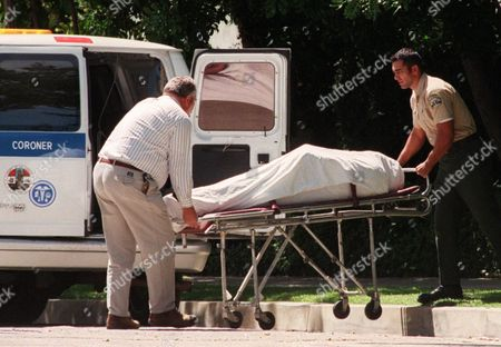 "PHIL HARTMAN The body of actor and comedian Phil Hartman is wheeled into a Los Angeles County coroner's van outside his home in the Encino section of Los Angeles, . Hartman, an alumnus of Saturday Night Live and actor on NBC's ""News Radio,"" and his wife were found dead in their home Thursday morning. Police officers responding to a 911 call were removing two children from the home when Hartman's wife, Brynn, 40, killed herself in another part of the house, LAPD Lt. Anthony Alba said"