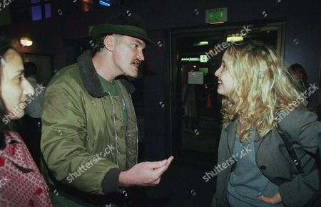 Quentin Tarantino, Julie Delpy Writer-director Quentin Tarantino mingles with French actress Julie Delpy at the premiere of the new John Waters-directed film ?Pecker? in Santa Monica, California