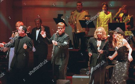 "POITIE Elton John, center, is joined on stage by, from left, Trudy Styler, Billy Joel, Sidney Poitier, Roberta Flack and Madonna as they sing ""With a Little Help From My Friends"" for the finale of the Rainforest Foundation International concert at Carnegie Hall in New York . The concert, expected to raise over $2 million, capped a week of events to raise awareness and raise funds for the Rainforest Foundation"