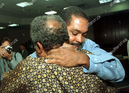 JOHNSON Calvin Johnson Jr., right, hugs his father Calvin Johnson Sr., after a judge freed him in a Jonesboro, Ga., courtroom. Johnson, who spent 16 years behind bars for a brutal rape, was cleared after DNA evidence proved another man was responsible for the crime