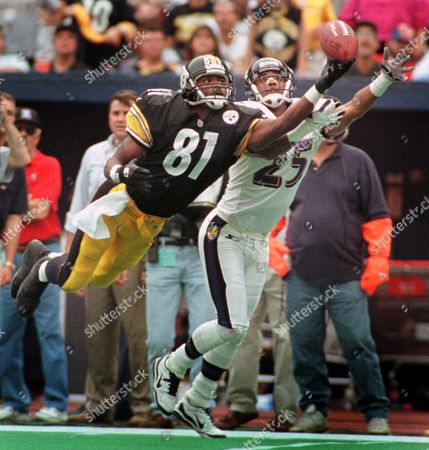 Stock Picture of JOHNSON JENKINS Pittsburgh Steelers wide receiver Charles Johnson (81) dives for a pass by quarterback Kordell Stewart in the second half as Baltimore Ravens' DeRon Jenkins defends in Pittsburgh on . The pass fell incomplete. The Steelers won 16-6