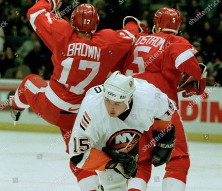 DONATO LIDSTROM BROWN Detroit Red Wings' Doug Brown (17) and Nicklas Lidstrom (5) put the squeeze on New York Islanders' Ted Donato (15) as he tries to skate through the defense during the first period at Nassau Coliseum in Uniondale, N.Y