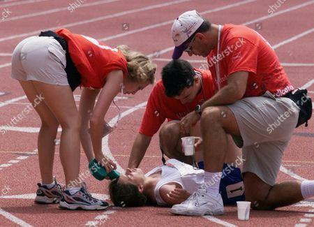 SMITH Medical personnel attend to Alison Smith, of Conn., after she collasped at the end of her 800 meters dash race during the 1999 Special Olympics World Summer Games in Raleigh, N.C., . Smith was not seriously injured