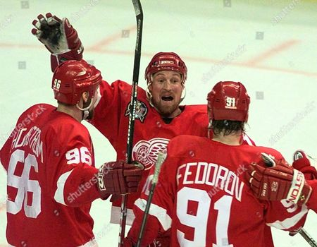 BROWN FEDEROV HOLMSTROM Detroit Red Wings' Doug Brown, center, celebrates with teammates Tomas Holmstrom, left, and Sergei Fedorov after his first period goal during Game 4 of the Stanley Cup Finals against the Washington Capitals, at the MCI Center in Washington