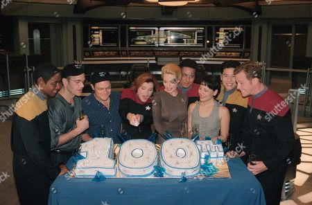 Kate Mulgrew, Tim Russ, Robert Picardo, Ethan Phillips, Jeri Ryan, Robert Beltran, Roxann Dawson, Garrett Wang, Robert Duncan McNeill Kate Mulgrew, fourth from left, cuts the cake as fellow cast members of ?Star Trek: Voyager? celebrate the filming of the Paramount Network Television series 100th episode on the Paramount lot in Los Angeles, . From left are Tim Russ, Robert Picardo, Ethan Phillips, Mulgrew, Jeri Ryan, Robert Beltran, Roxann Dawson, Garrett Wang and Robert Duncan McNeill. ?Star Trek: Voyager? enters its fifth series this fall on UPN