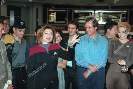Stock Photo of Kate Mulgrew Kate Mulgrew, who stars as Capt. Kathryn Janeway on ?Star Trek: Voyager,? acknowledges cast, crew and writers for the success of the Paramount Network Television show at a party celebrating the filming of the series 100th episode on the Paramount lot in Los Angeles, . From left are cast members Robert Picardo, Ethan Phillips (partly hidden) and Roxann Dawson, executive producer Brannon Braga, creator and executive producer Rick Berman, and cast members Garrett Wang and Jeri Ryan. The series begins its fifth season on UPN in the fall
