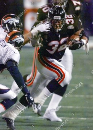 ANDERSON Atlanta Falcons' Jamal Anderson runs in the first quarter of Super Bowl XXXIII against the Denver Broncos in Miami