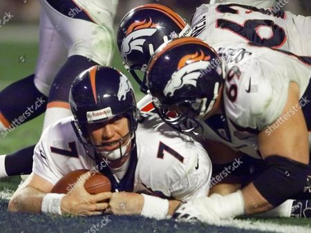 ELWAY Denver Broncos quarterback John Elway looks up after crossing the goal line in the fourth quarter of Super Bowl XXXIII in Miami, . The Broncos defeated the Atlanta Falcons 34-19. At right is Broncos lineman Mark Schlereth