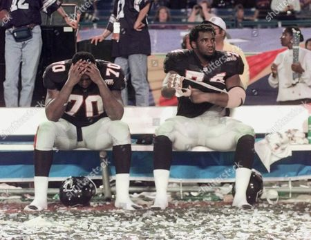 WHITFIELD SALAAM Atlanta Falcons Bob Whitfield (70) and Ephraim Salaam (74) sit on the bench surrounded by confetti following their 34-19 loss to the Denver Broncos in Super Bowl XXXIII in Miami