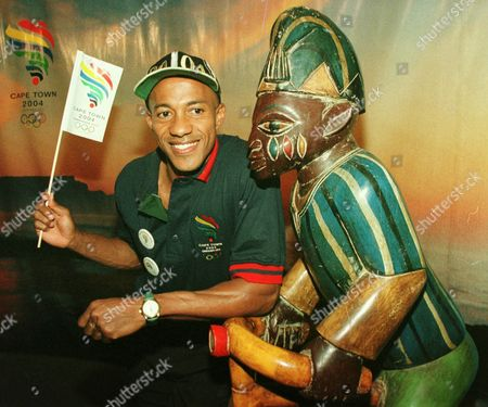 FREDERICKS Namibian sprinter Frankie Fredericks who supporst the bid of Cape Town for the Olympics 2004, poses next to a South African sculpture at the Palais de Beaulieu in Lausanne, Switzerland, . Cape Town and Stockholm Olympic bid organizers denied that they had offered gifts to International Olympic Committee officials to secure votes for the Olympic decision