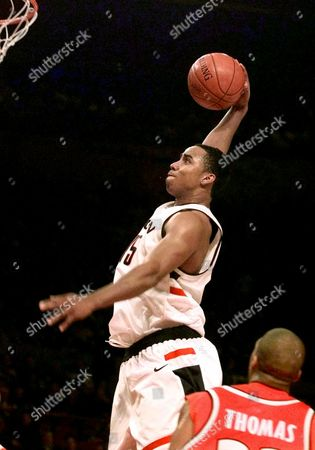 FREEMAN THOMAS Connecticut's Kevin Freeman goes up for a slam dunk in front of Syracuse's Etan Thomas during their semifinal game of the Big East Championship at Madison Square Garden in New York