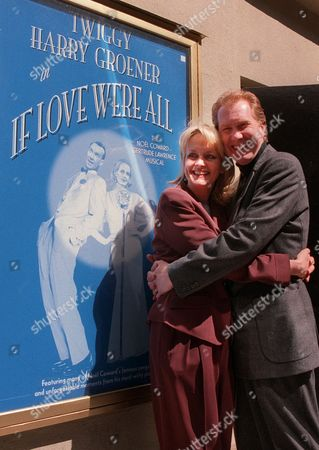 """TWIGGY Twiggy poses with her co-star, Harry Groener, outside the Lucille Lortel theatre in New York, where they will be staring as Gertrude Lawrence and Noel Coward in the upcoming romantic musical """"If Love Were All."""" Twiggy, who will turn 50 during the play's run, made her first splash in New York in 1967 as a 17-year-old international fashion model"""