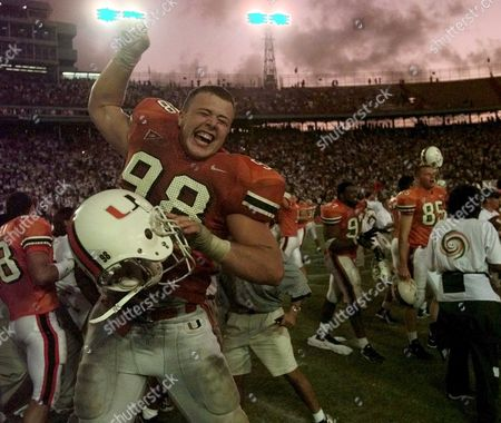 SWEENEY Miami defensive tackle Matt Sweeney (98) celebrates their upset victory over UCLA at the Orange Bowl in Miami. The Hurricanes upset the third ranked Bruins 49-45