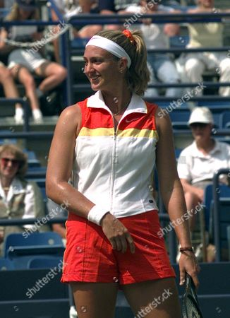 MARY PIERCE Sporting a bright tennis attire during her first round match, France's Mary Pierce smiles at opponent Gigi Fernandez at the U.S. Open tennis tournament in New York on