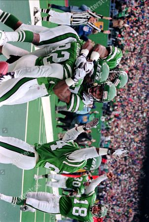 JOHNSON COLEMAN LUCAS New York Jets running back Leon Johnson (32) left, is hugged by teammates Raymond Austin (36) and Marcus Coleman (42) as teammates Ray Mickens (24) and Ray Lucas (18) join in the celebration after his 66-yard punt return for a touchdown against the Minnesota Vikings in the first quarter at Giants Stadium in East Rutherford, N.J