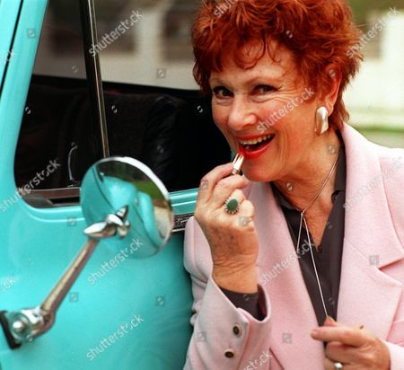 "ROSS Actress Marion Ross applies lipstick in a truck mirror, in the Studio City section of Los Angeles. She had just driven the 1955 truck from San Diego to use it on her Happy Days Farm in the Woodland Hills area of Los Angeles. Ross, who played the mother in the TV sitcom ""Happy Days,"" stars with Yasmine Bleeth in the NBC movie ""The Lake,"" which airs Feb. 1"