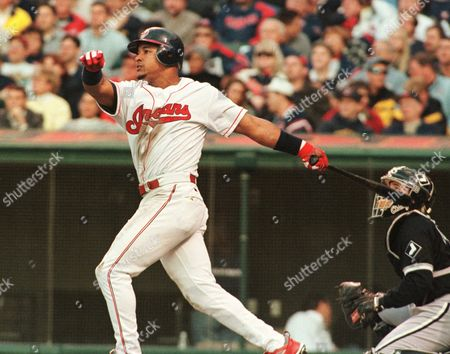 RAMIREZ Cleveland Indians' Manny Ramirez slugs a solo home run off chicago White Sox pitcher Mike Sirotka in the fourth inning of the Indians 6-2 win, in Cleveland. Chicago catcher Mark Johnson watches, right