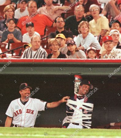 MARTINEZ SABERHAGEN Boston Red Sox pitcher Pedro Martinez, right, laughs as teammate Bret Saberhagen, left, checks the tape after he and some teammates tapped Martinez to a dugout pole during the ninth inning of Boston's 6-1 win over the Chicago White Sox at Fenway Park in Boston