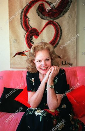 """BAKER 26-28--Actress Carroll Baker poses for a photo at her apartment, in Los Angeles. Baker, the classy blonde in the films """"Giant"""" and """"Baby Doll,"""" has a new role at age 66 in the Michael Douglas-Sean Penn thriller """"The Game"""