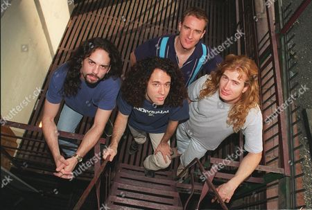 """ELLEFSON Members of the band Megadeth pose in New York . The heavy metal band's bassist, David Ellefson, has written a how-to book about the music business: """"Making Music Your Business: A Guide for Young Musicians."""" From left, are Nick Menza, Marty Friedman, Ellefson and David Mustaine"""