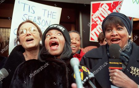 STEINEM MOORE TUCKER Gloria Steinem, left, Melba Moore and C. Delores Tucker sing during a protest outside Time Warner offices in New York . Women activists brought a different kind of Christmas carol to Time Warner offices Thursday to protest song lyrics they say promote violence against women