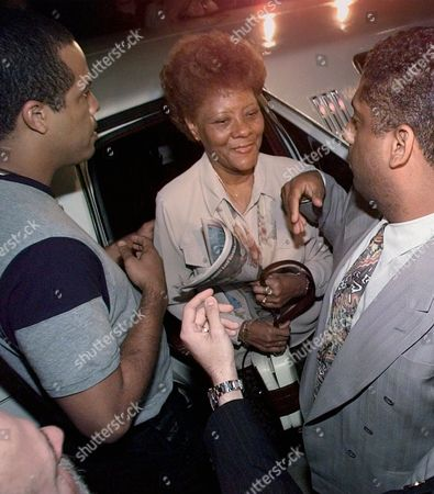 MIRIAM CARRERAS Miriam Carreras, mother of Florida Marlins pitcher Livan Hernandez leaves her limousine at Pro Player Stadium after arriving from Cuba for Game Seven of the World Series, in Miami. Others in photo are unidentified. Carreras received speical permission from the U.S. and Cuba to travel to the United States to attend the game