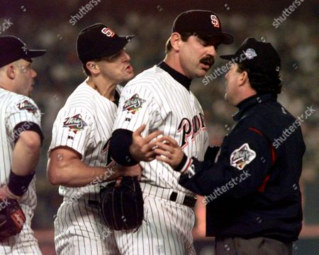 San Diego Padres, from left, first baseman Jim Leyritz, pitcher Kevin Brown and manager Bruce Bochy argue a call with first base umpire Tim Tschida in the 8th inning during Game 4 of the World Series at Qualcomm Stadium in San Diego, Calif., . Bochy intercepted after Brown began arguing with Tschida after Tschida called Yankee runner Paul O'Neill safe at first