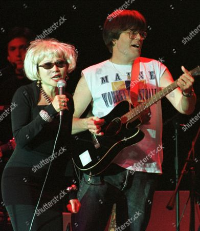 TAN KING Novelist Amy Tan and horror writer Stephen King perform as part of the Rock Bottom Remainders rock group in Bangor, Maine, Friday night, . The group of well known word people perfomed in King's hometown to raise money for a local charity