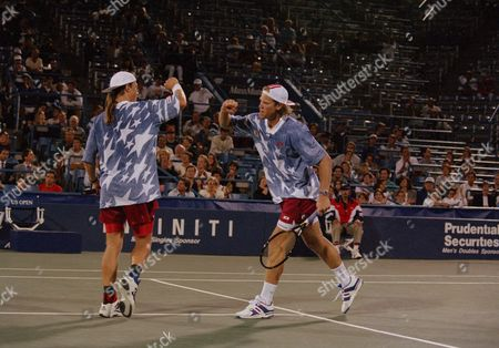 Luke Jensen, Murphy Jensen Luke Jensen, left, of Ludington, Mich., and his brother Murphy Jensen of Norcross, Ga., bump fists as they play a match against tenth seeded Scott Melville of Tonte Vedra Beach, Fla., and Piet Norval of South Africa, during the men's doubles competition at the U.S. Open in New York, . The Jensen brothers won their first round match 6-2, 7-6, (8-6