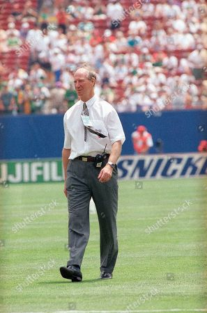 Irish coach Jack Charlton, with a radio phone at his belt, leaves the pitch en route to the stands at Giants Stadium, East Rutherford, N.J., on shortly before the Ireland Vs. Norway Group E World Cup soccer opening round match. Charlton has been banned from the field by FIFA (International Federation of Football Association) for allegedly arguing with a FIFA official during Ireland's match against Mexico on the substitution of Irish player John Aldrige. Charlton will watch the game from a box in the stands and radio instructions to his assistant officially coaching the team