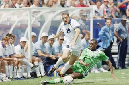 Italy's Daniele Massaro, left, challenges Nigerian soccer player Mike Emenalo, right, during first half action in their second round World Cup soccer match at Foxboro Stadium; in Foxboro, Mass. The winner of this match will play Spain in the quarterfinals of the World Cup in Foxboro on Saturday, July 9
