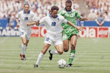 Italian forward Roberto Baggio runs by Nigerian defender Michael Emenalo, right, during the World Cup soccer championship second round match, in Foxboro, Mass. Left is Italian forward Daniele Massaro. Baggio tied the game for Italy in the second half, and scored on a penalty kick in overtime
