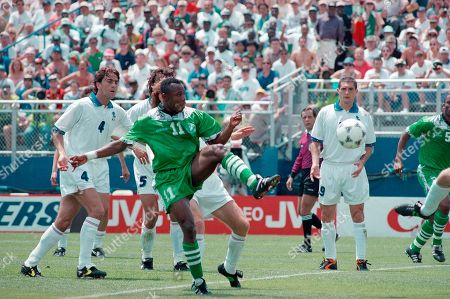 Nigerian forward Emmanuel Amunike kicks the ball at the net for a first half goal in the World Cup soccer championship second-round match against Italy, in Foxboro, Mass. Italian players include, from left: Alessandro Costacurta, Paoloa Maldini (5, partly hidden) and Daniele Massaro, right