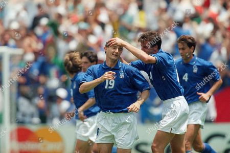 Italy's Daniele Massaro (19) celebrates his second half goal with his teammate Nicola Berti, right, during the Italy Vs. Mexico Group E World Cup match on at Washington's RFK Stadium. Italy tied with Mexico 1-1 and places third in Group E. Their participation in the next round depends on the results in other groups
