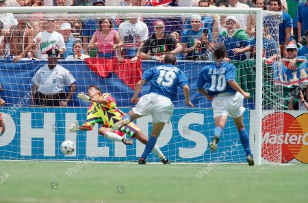 Italy's Daniele Massaro (19) kicks a goal past Mexico's Jorge Campos during the second half of the Italy Mexico Group E World Cup match on at Washington's RFK Stadium. Italy and Mexico tied 1-1. Mexico automatically advances to the next round; Italy must wait for the results of other matches